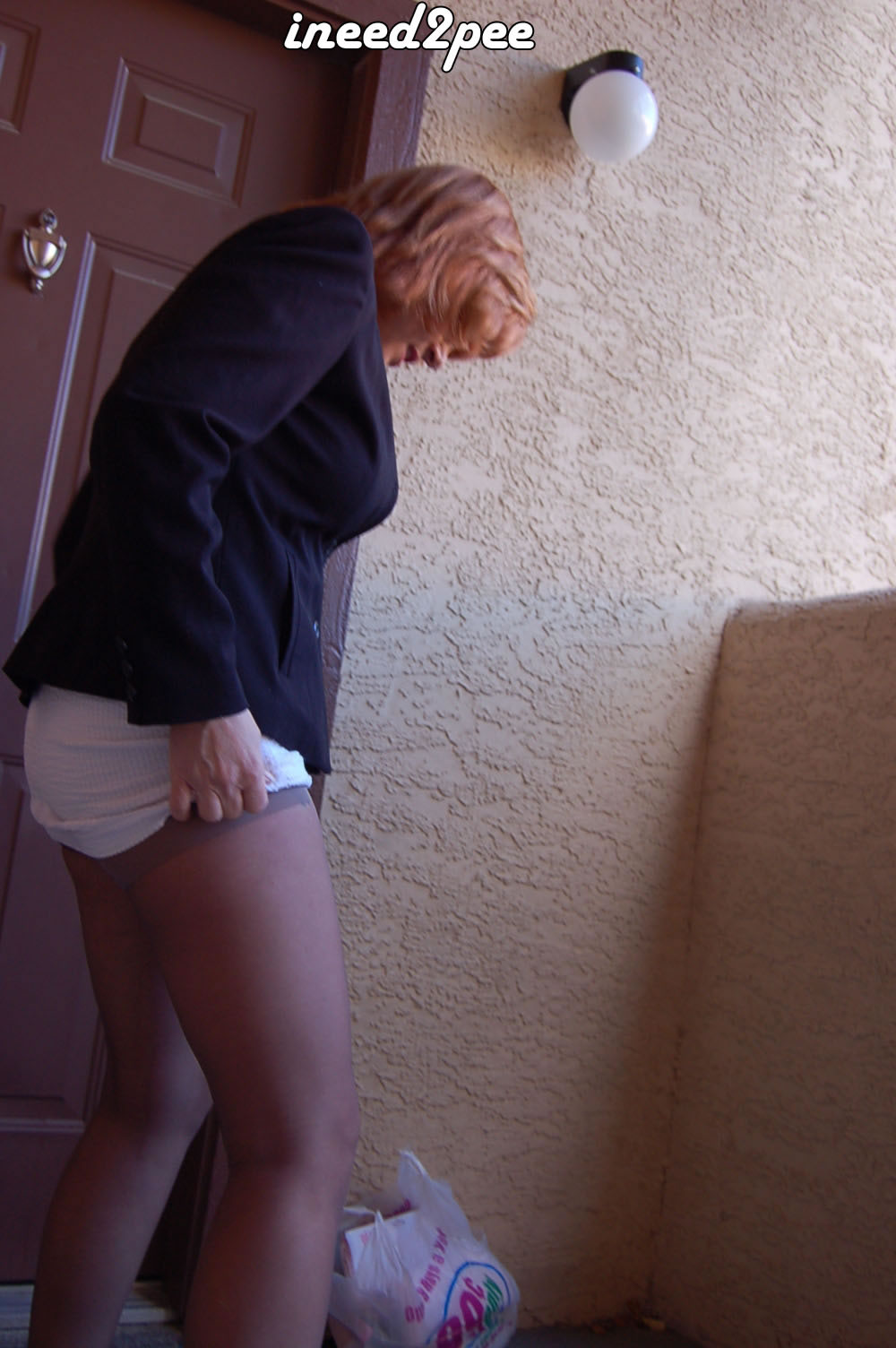 wetting her pants female desperation ineed2pee